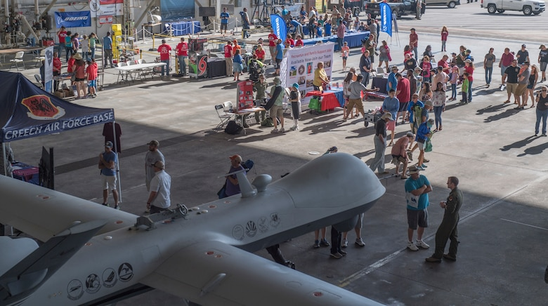 Attendees visit multiple exibits during the Joint Base Charleston Air and Space Expo at JB Charleston, S.C.  Apr 28, 2018.