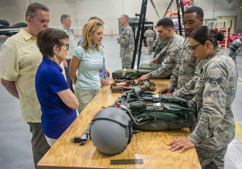 Airmen from the 20th Expeditionary Bomb Squadron brief a group of Air Force civic leaders in a hangar on Andersen Air Force Base, Guam, April 28, 2018. Air Force civic leaders are unpaid advisers, key communicators and advocates for the Air Force. (U.S. Air Force photo by Airman 1st Class Christopher Quail)