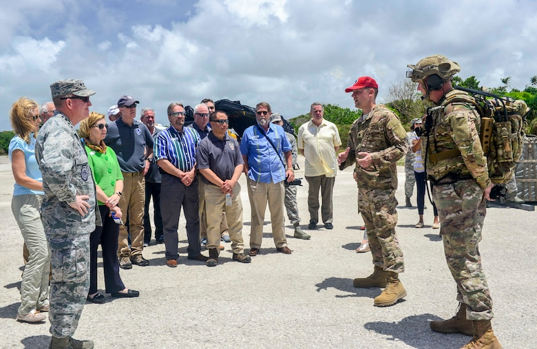 Expeditionary engineers of 554th RED HORSE Assault Assessment and Repair Operations brief Air Force Vice Chief of Staff Gen. Stephen Wilson and a group of Air Force civic leaders at North-west Field, Andersen Air Force Base, Guam, April 28, 2018. Civic leader visits offer select community members access to military missions to encourage and foster positive relationships between the local hosts and military communities. (U.S. Air Force photo by Airman 1st Class Christopher Quail)