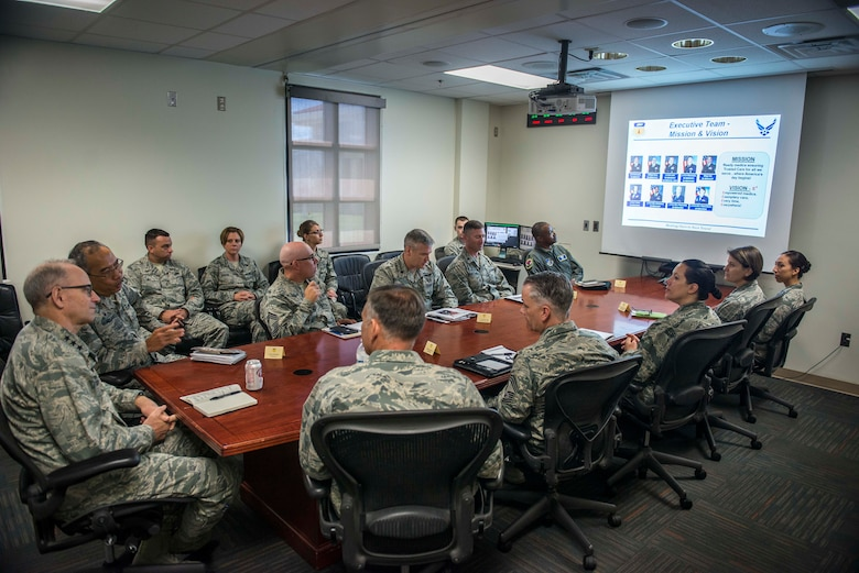 Leadership from the 36th Medical Group squadron briefs U.S. Air Force Lt. Gen Mark A. Ediger, Surgeon General of the Air Force, during his visit April 17, 2018, to Andersen Air Force Base, Guam. Leadership discuss some of the unique aspects of running a medical squadron on an island distant away. (U.S. Air Force Photo by Airman 1st Class Christopher Quail)