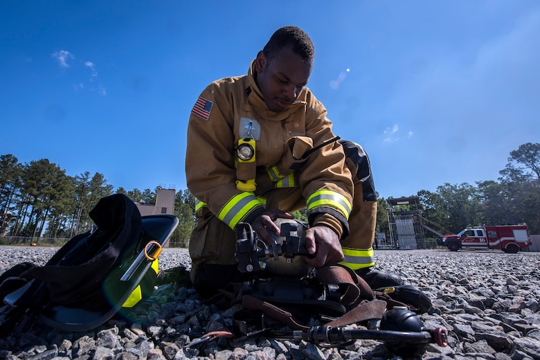 A firefighter from the 23d Civil Engineer Squadron (CES) inspects his oxygen tank following live-fire training, April 25, 2018, at Moody Air Force Base, Ga.  Firefighters from the 23d CES and Valdosta Fire Department participated in the training to gain more experience fighting aircraft fires and to work together as a cohesive team while still practicing proper and safe firefighting techniques. (U.S. Air Force photo by Airman Eugene Oliver)