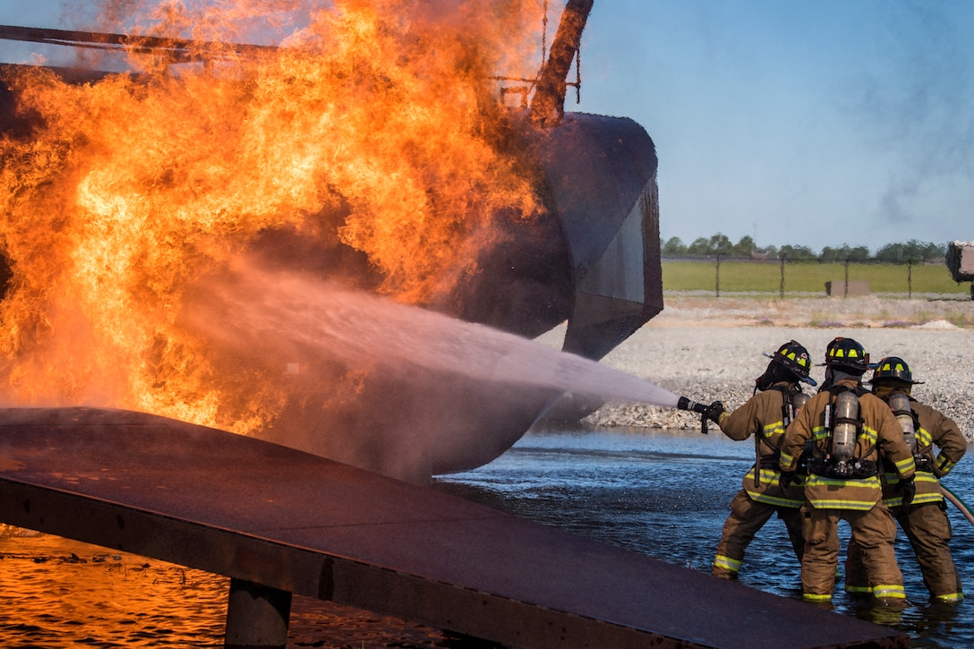 Firefighters from the Valdosta Fire Department (VFD) extinguish an aircraft fire during live-fire training, April 25, 2018, at Moody Air Force Base, Ga. Firefighters from the 23d Civil Engineer Squadron and VFD participated in the training to gain more experience fighting aircraft fires and to work together as a cohesive team while still practicing proper and safe firefighting techniques. (U.S. Air Force photo by Airman Eugene Oliver)
