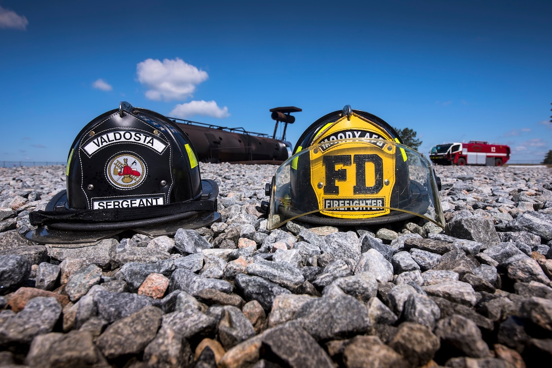 Helmets rest on the ground following live-fire training, April 25, 2018, at Moody Air Force Base, Ga.  Firefighters from the 23d Civil Engineer Squadron and Valdosta Fire Department participated in the training to gain more experience fighting aircraft fires and to work together as a cohesive team while still practicing proper and safe firefighting techniques. (U.S. Air Force photo by Airman Eugene Oliver)