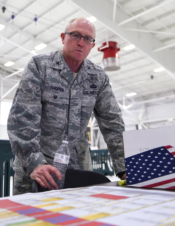 U.S. Air Force Col. Charlie Thigpen, deputy director for the Office of the Air Surgeon, reviews the schedule of events in St. Paul, Minn., April 20, 2018.