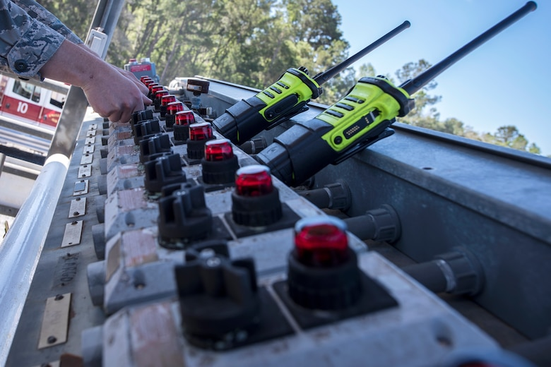 An Airman from the 23d Civil Engineer Squadron (CES) operates an ignition control panel during live-fire training, April 25, 2018, at Moody Air Force Base, Ga. Firefighters from the 23d CES and Valdosta Fire Department participated in the training to gain more experience fighting aircraft fires and to work together as a cohesive team while still practicing proper and safe firefighting techniques. (U.S. Air Force photo by Airman Eugene Oliver)