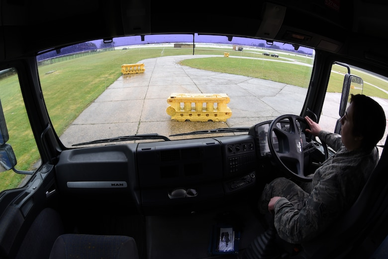 A vehicle operator assigned to the 100th Logistic Readiness Squadron navigates a tractor trailer through a driving course at Royal Air Force Lakenheath, England, April 27, 2018. The 48th LRS hosted a ground transportation rodeo where Airmen from both squadrons competed against each other in events to test their driving skills. (U.S. Air Force photo by Senior Airman Eli Chevalier)