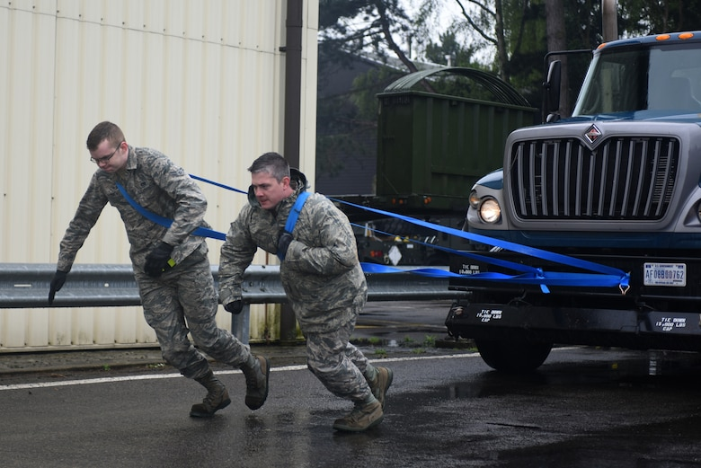 Airmen from the 100th Logistic Readiness Squadron pull a tractor trailer during a ground transportation rodeo at Royal Air Force Lakenheath, England, April 27, 2018. The rodeo offered the opportunity for Airmen from the 48th and 100th LRS the chance to network and compete against their counterparts in a variety of events.(U.S. Air Force photo by Senior Airman Eli Chevalier)