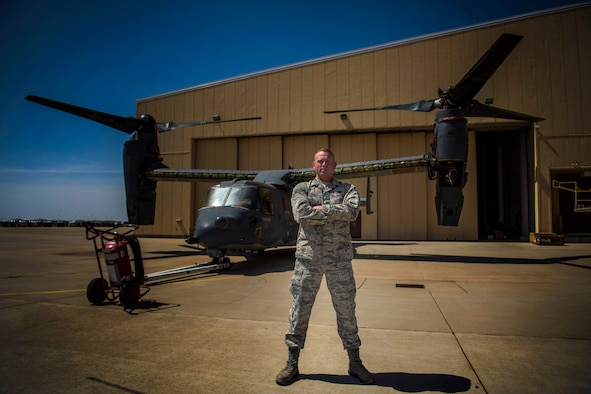 Airman 1st Class Justin Rau, 727th Special Operations Aircraft Maintenance Squadron with the 20th Aircraft Maintenance Unit, stands in front of a CV-22 Osprey at Cannon Air Force Base, N.M., April 27, 2018. Rau was last month's Diamond Sharp Award winner that highlights Airmen representing Cannon's finest. (U.S. Air Force photo by Senior Airman Luke Kitterman/Released)