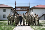 Multi-National Battle Group - East Cmdr. Col. Nick Ducich, members of his staff and Soldiers from NATO Headquarter -Sarajevo pose for a picture at Camp Butmir in Sarajevo, Bosnia and Herzegovina, April 24, 2018. Each Kosovo Force (KFOR) rotation provides Soldiers for NATO Headquarters- Sarajevo to oversee Camp Butmir, support the Bosnia and Herzegovina training mission, and provide essential services on the camp for the European Union Force Althea (EUFOR Althea) peacekeeping element.