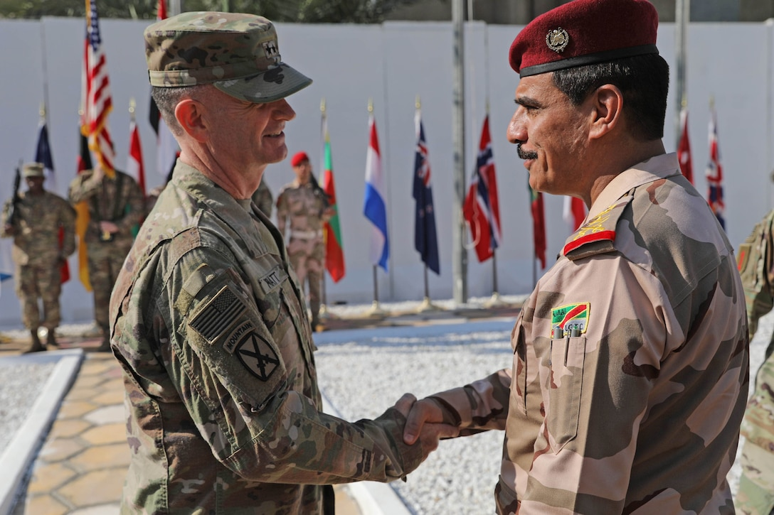 Maj. Gen. Walter Piatt, commander of Combined Joint Forces Land Component Command, shakes hands with Iraqi staff Lt. Gen. Abdul Amir al-Lami, deputy commander of Iraq Joint Operations Command, during the CJFLCC deactivation ceremony in Baghdad, Iraq, April 30, 2018. The deactivation signifies the end of major combat operations against ISIS in Iraq and acknowledges the changing composition and responsibilities of the Coalition.  (U.S. Army photo by Master Sgt. Horace Murray)