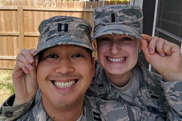 CAVALIER AIR FORCE STATION, N.D. - Capt. Scott Lagarile, 10th Space Warning Squadron, and his wife, 1st Lt. Emily Lagarile, 10th SWS chief of training, tip their Airmen Battle Uniform caps while stationed at Cavalier Air Force Station, N.D. The Lagariles operate the Perimeter Acquisition Radar Attack Characterization System, protecting our northern border from potential missile attacks by providing critical missile warning capability to the nation's leaders. (Courtesy photo)