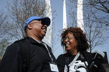 Air Force veteran Chris Jackson and his wife, Desralai Jackson, share a laugh and reminisce at the Air Force Memorial April 21 as they discuss their involvement from 1984-1987 with the Berlin for Lunch Bunch in Germany.