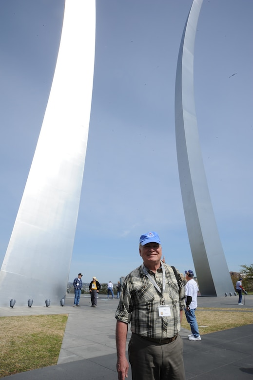 Former program manager Monty Hand, Berlin for Lunch Bunch member who flew the mission from 1986-1991 with two years at Rhein Main and almost two years at U.S. Air Forces in Europe headquarters in Ramstein Air Base, Germany, stands before the Air Force Memorial's signature spires April 21.