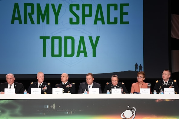 "COLORADO SPRINGS, Colo. - U.S. Army Space and Missile Defense Command/Army Forces Strategic Command's former commanding general retired Lt. Gen. Richard Formica serves as moderator for a seven-member panel focused on ""Army Space Today"" during the 34th Space Symposium at the Broadmoor in Colorado Springs April 19. Brig. Gen. Tim Lawson, deputy commanding general for operations, U.S. Army Space and Missile Defense Command/Army Forces Strategic Command, talked about the Army's use of space during the panel. (Courtesy photo)"