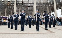 The U.S. Air Force Drill Team performs in front of students at The University of Texas at San Antonio April 20, 2018, San Antonio, Texas. A standard Drill Team performance features a professionally choreographed sequence of show-stopping weapon maneuvers, precise tosses, complex weapon exchanges, and a walk through the gauntlet of spinning weapons. (U.S. Air Force photo by Airman 1st Class Dillon Parker)