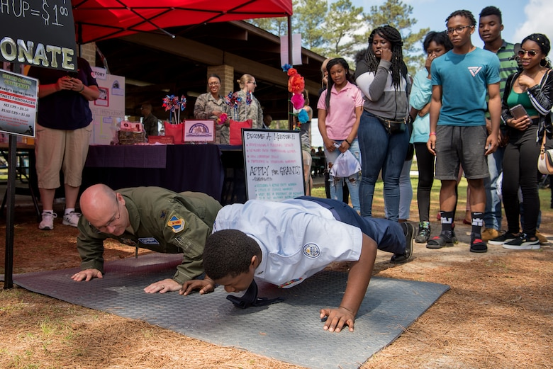 Col. Richard Dickens, 4th Operations Group commander, challenges an Air Force Junior ROTC cadet to a push-up challenge during a Diversity Day celebration, April 27, 2018, at Seymour Johnson Air Force Base, North Carolina.