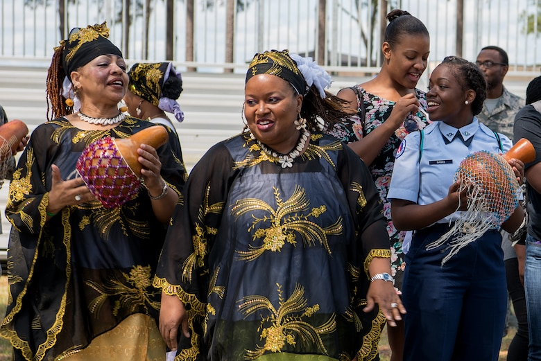 A group performs a traditional African dance with the crowd during a Diversity Day celebration, April 27, 2018, at Seymour Johnson Air Force Base, North Carolina.