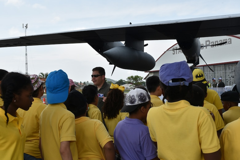 Maj. Rafael Salort, 53rd Weather Reconnaissance Squadron navigator, briefs to groups of students about the hurricane hunter mission during the 2018 Caribbean Hurricane Awareness Tour, April 23-28. The tour is a combined effort of the 53rd WRS, also known as the Air Force Reserve Hurricane Hunters, and the National Oceanic and Atmospheric Administration designed to help communities in Mexico and the Caribbean prepare for the season and the coming storms. Visitors toured a WC-130J Super Hercules hurricane hunter aircraft and the NOAA Gulfstream IV. (U.S. Air Force photo by Master Sgt. Jessica Kendziorek)