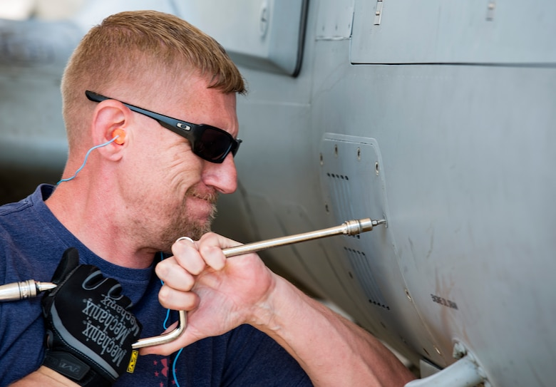 Joe Johnson, Sierra Nevada Corporation (SNC) avionics technician, unscrews an access panel on an A-29 Super Tucano, April 26, 2018, at Moody Air Force Base, Ga. The 81st Fighter Squadron received the aircraft to help continue the Afghan light air support training mission, which ultimately provides Afghan pilots with the capabilities of finding, tracking, and attacking targets either on their own or in support of ground forces. The aircraft will be used by the Afghan Air Force for close-air attack, air interdiction, escort and armed reconnaissance. SNC is an American privately held electronic systems provider and systems integrator, and are the primary technicians and pilot instructors of the A-29s. (U.S. Air Force photo by Airman 1st Class Erick Requadt)