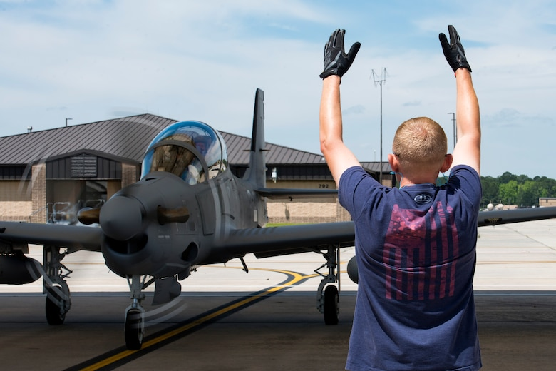 Joe Johnson, Sierra Nevada Corporation (SNC) avionics technician, taxis an A-29 Super Tucano, April 26, 2018, at Moody Air Force Base, Ga. The 81st Fighter Squadron received the aircraft to help continue the Afghan light air support training mission, which ultimately provides Afghan pilots with the capabilities of finding, tracking, and attacking targets either on their own or in support of ground forces. The aircraft will be used by the Afghan Air Force for close-air attack, air interdiction, escort and armed reconnaissance. SNC is an American privately held electronic systems provider and systems integrator, and are the primary technicians and pilot instructors of the A-29s. (U.S. Air Force photo by Airman 1st Class Erick Requadt)