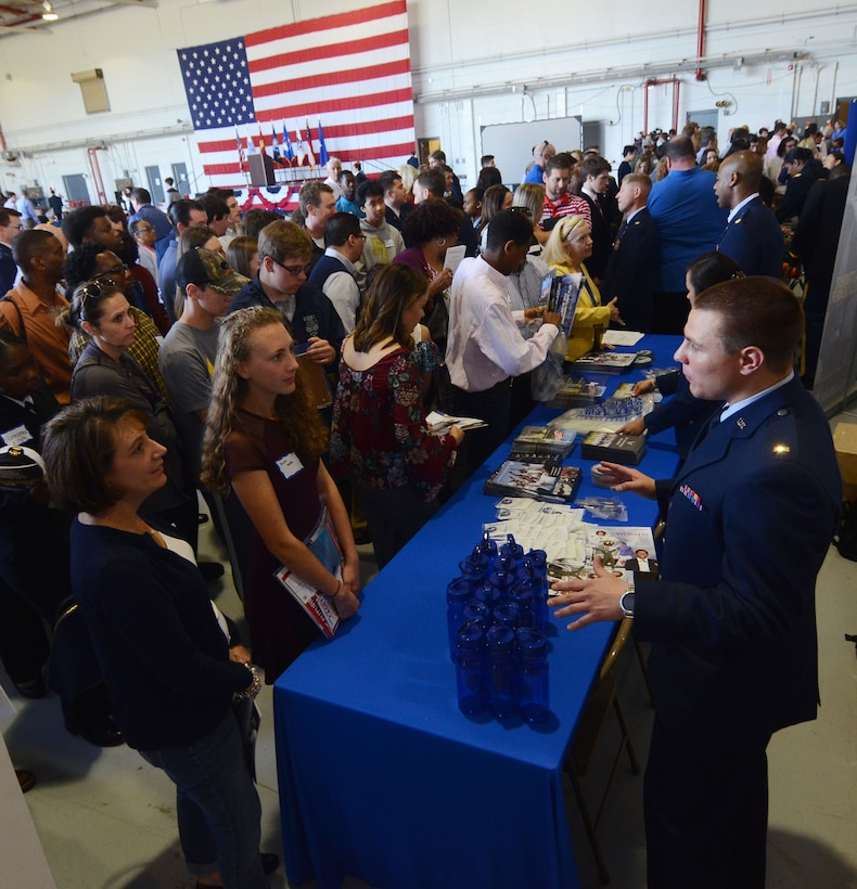 Attendees line up at a U.S. Air Force Academy information table at this year's Academy Day, held at Dobbins Air Reserve Base, Ga. April 28, 2018. U.S. military academies set up information tables for future applicants to ask questions about the application process. (U.S. Air Force photo/Don Peek)