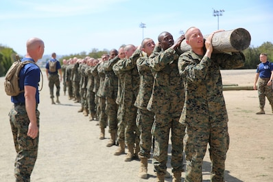 Recruits with Mike Company, 3rd Recruit Training Battalion, carry a log during a log drill exercise at Marine Corps Recruit Depot San Diego, April 23.