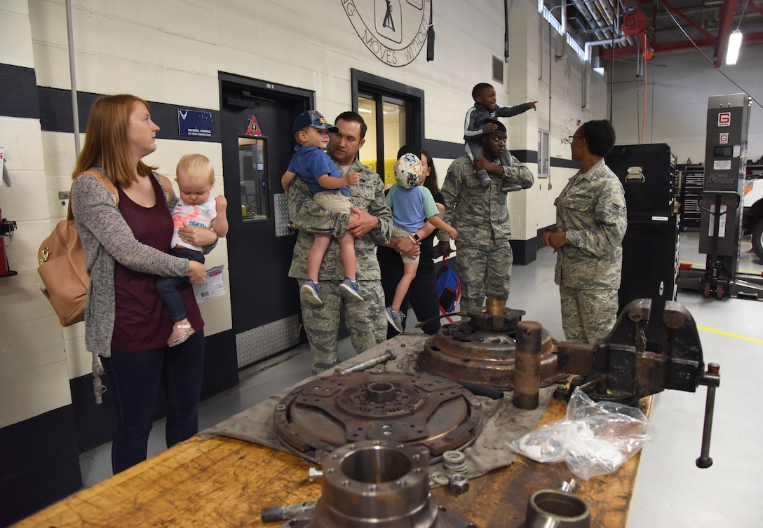 Members of the 81st Logistics Readiness Squadron take their children on a tour of the vehicle maintenance building during the 81st LRS Bring Your Child to Work Day event at Keesler Air Force Base, Mississippi, April 26, 2018. The event allowed children the opportunity to experience what their parents do at work by touring facilities while receiving hands-on experiences. (U.S. Air Force photo by Kemberly Groue)