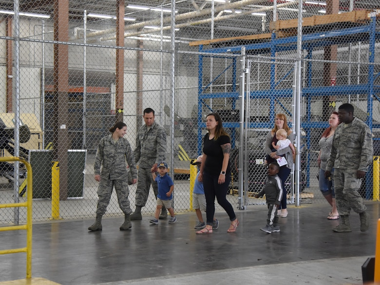 Members of the 81st Logistics Readiness Squadron take their children on a tour of the supply warehouse at the Taylor Logistics Center during the 81st LRS Bring Your Child to Work Day event at Keesler Air Force Base, Mississippi, April 26, 2018. The event allowed children the opportunity to experience what their parents do at work by touring facilities while receiving hands-on experiences. (U.S. Air Force photo by Kemberly Groue)