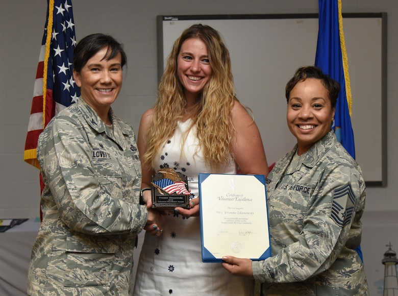 U.S. Air Force Col. Debra Lovette, 81st Training Wing commander, and Chief Master Sgt. Tanya Johnson, 81st Diagnostic and Therapeutics Squadron superintendent, presents Yvonne Zdanowski, spouse of 2nd Lt. Paul Zdanowski, 81st Force Support Squadron resource management officer in charge, with a Volunteer Excellence certificate during the 2018 Volunteer Appreciation Ceremony at the Sablich Center at Keesler Air Force Base, Mississippi, April 26, 2018. The event recognized Keesler personnel, family members and retirees for their volunteer service in 2017. (U.S. Air Force photo by Kemberly Groue)
