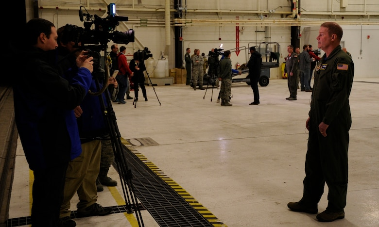 Col. James DeVere, 302nd Airlift Wing commander, speaks with local news crews during the wing's Modular Airborne Fire Fighting System Media Day, April 20, 2018, at Peterson Air Force Base, Colorado.