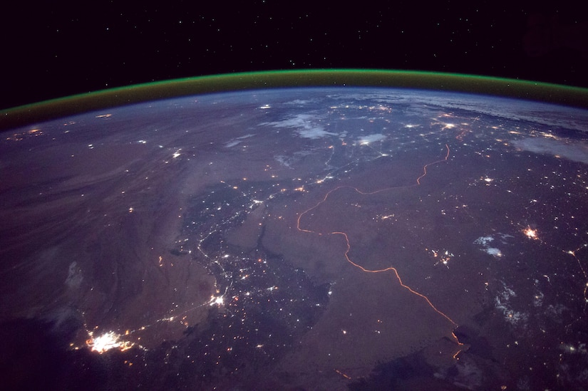 The India-Pakistan border is among the most heavily armed borders in the world; both countries possess nuclear weapons, including tactical nuclear weapons. The orange line snaking across the center of the image is a fenced floodlit border zone between India and Pakistan that is one of the few places on earth where an international boundary can be seen at night (NASA).