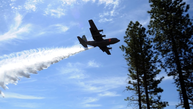 A C-130 Hercules aircraft equipped with a U.S. Department of Agriculture Forest Service Modular Airborne Fire Fighting System drops water over the Tahoe National Forest, California, April 26, 2018.