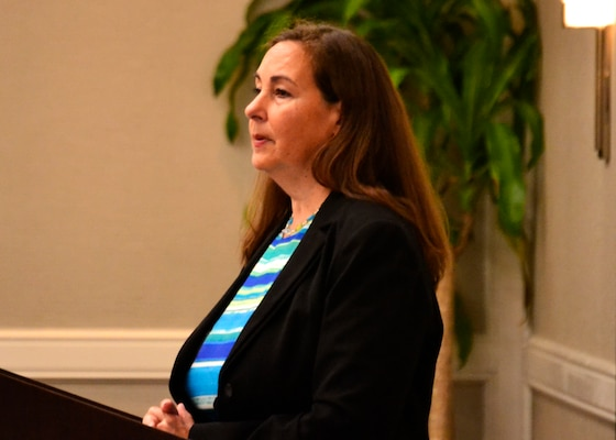 Janine Samoni, strategic material sourcing group division chief with the Subsistence supply chain, speaks to a group of industry representatives during a DLA Ingredients Industry Day July 19. The event focused on making the process of restricting or banning ingredients from the Joint Service Buyer's Guide more transparent to industry and manufacturers.