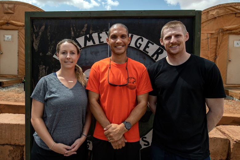 U.S. Air Force Capt. Melanie Gates, left, Capt. Nick McKenzie, and Capt. Richard Thorsted, all who are Special Operations Command Forward Northwest Africa ground surgical team members, gather for a photo at Nigerien Air Base 101, Niamey, Niger, on June 21, 2018. The three doctors recently finished medical school and are serving their first deployment. They are deployed from Travis Air Force Base, California.  (U.S. Air Force courtesy photo)
