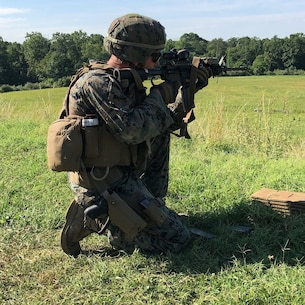 A Marine from 4th platoon, Charlie Co.,  Fleet Anti-terrorism Security Team, U.S. Marine Corps Security Forces, conducts unknown distance live fire evolution aboard Marine Corps Base Quantico July 25.  Marines additionally utilized various standard and non-standard shooting positions to simulate engaging targets from various pieces of terrain and cover that would be located throughout the battlespace. (Official U.S. Marine Corps photo by Capt. John McCourt/Released)