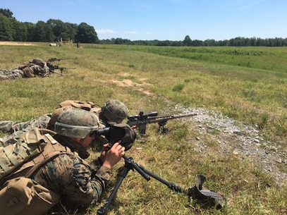 A Designated marksman from 4th platoon, Charlie Co.,  Fleet Anti-terrorism Security Team, U.S. Marine Corps Security Forces conduct live fire training at unknown distances utilizing their M110 SASS and SSOT to identify targets at various distances and provide precision marksmanship Marine Corps Base Quantico July 25.  Marines additionally utilized various standard and non-standard shooting positions to simulate engaging targets from various pieces of terrain and cover that would be located throughout the battlespace. (Official U.S. Marine Corps photo by Capt. John McCourt/Released)