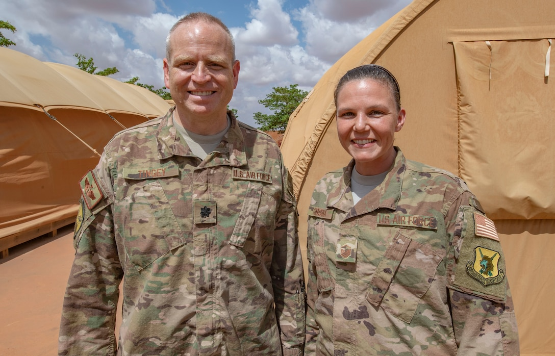 Lt. Col. Justin Tingey, 768th Expeditionary Air Base Squadron flight doctor, and Master Sgt. Melissa Cessna, 768th EABS independent duty medical technician, pose for a photo at Nigerien Air Base 101, Niamey, Niger, on June 21, 2018. The team recently set up a walking blood bank to enable life-saving surgery to an Italian woman who nearly died in a car accident outside the base. The patient is now in good condition and recovering in Italy. (U.S. Air Force courtesy photo)
