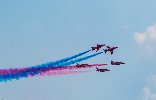 The Royal Air Force Aerobatic Team, The Red Arrows, perform aerial displays at the RAF Marham Families and Friends Day at RAF Marham, England, July 26, 2018. U.S. Airmen and families from RAF Lakenheath and RAF Mildenhall joined RAF partners in celebrating the RAF's 100th anniversary. (U.S. Air Force photo/by Airman 1st Class Shanice Williams-Jones)