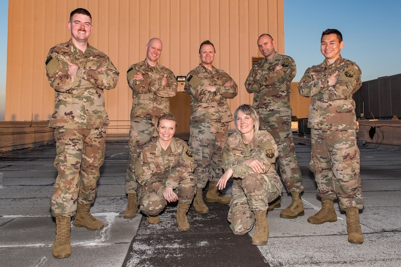 """U.S. Air Force Band of The West rock band """"Top Flight"""", who are deploying to be the U.S. Air Forces Central Command (AFCENT) Band conducted a photo shoot above Joint Base San Antonio-Lackland, Texas March 21, 2018 . For the first time since 2011, the U.S. Air Forces Central Command Band deployed to and performed in Iraq in June. (U.S. Air Force photo by Andrew C. Patterson)"""