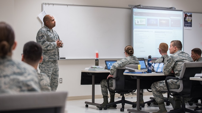 Tech. Sgt. Ricardo Lemos Rodriguez, noncommissioned officer in charge of the Force Health Management Branch, mentors the Public Health apprentice students to prepare them for the operational Air Force. He discusses how they can navigate the Air Force Portal to locate information on Air Force priorities, career development and education. (U.S. Air Force photo by Richard  Eldridge)