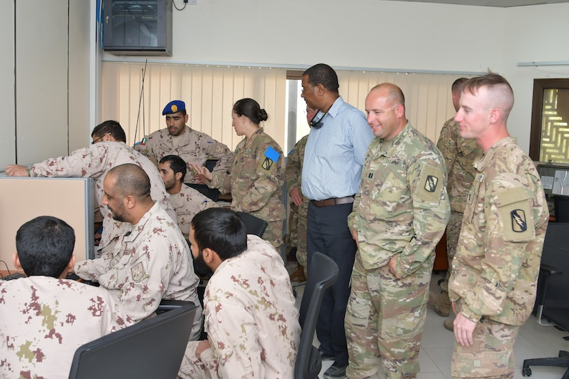 Soldiers with 155th Armored Brigade Combat Team (Mississippi Army National Guard), Task Force Spartan and the United Arab Emirates Land Force Component discusses courses of action during the Iron Union 7 exercise July 9, 2018. The exercise brought together U.S. and Emirati soldiers to improve coordination and communication.