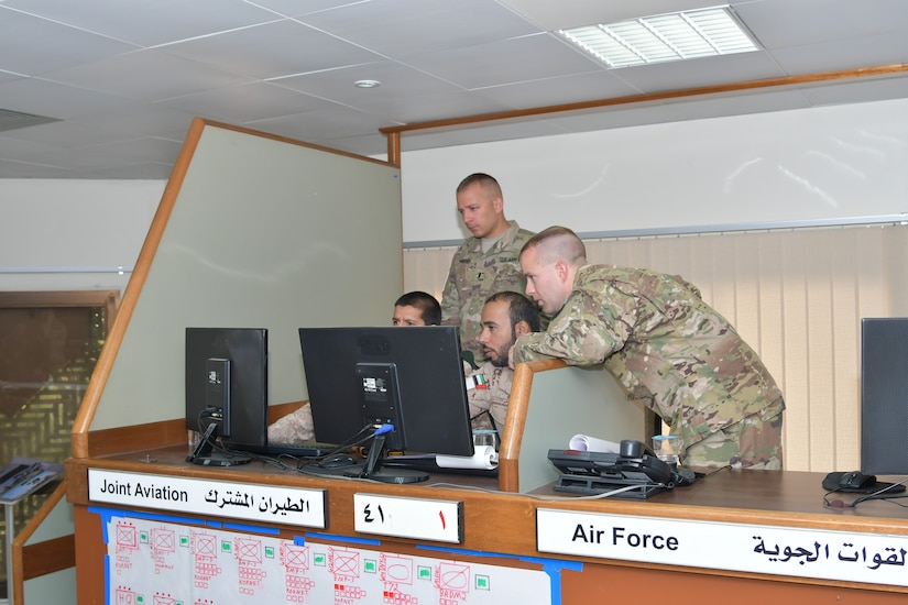 Soldiers with Task Force Spartan and the United Arab Emirates Land Force Component discusses courses of action during the Iron Union 7 exercise July 9, 2018. The exercise brought together U.S. and Emirati soldiers to improve coordination and communication.