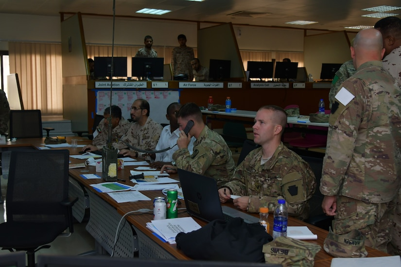 Soldiers with Task Force Spartan and the United Arab Emirates Land Force Component staff the operations center during the Iron Union 7 exercise July 9, 2018. The exercise brought together U.S. and Emirati soldiers to improve coordination and communication.