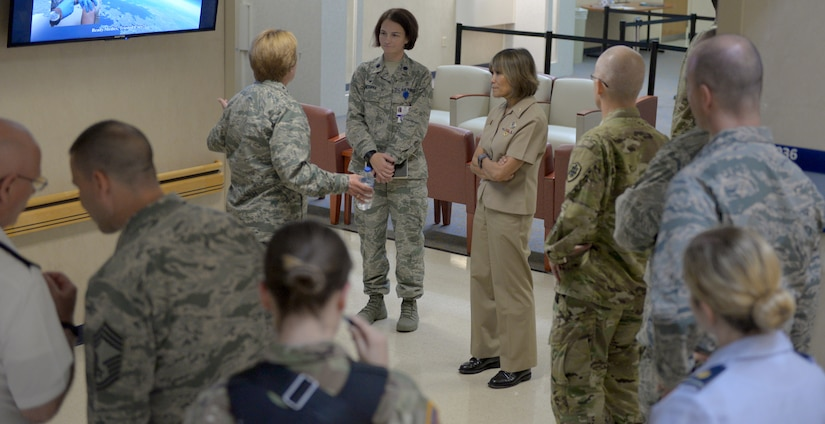 Members of the Defense Health Agency and Lt. Gen. Dorothy Hogg, U.S. Air Force surgeon general, take a tour of the 628th Medical Group facility during their July 30, 2018, visit to Joint Base Charleston. The visit allowed the group to develop a better understanding of the medical services provided by the 628th MDG as it transitions to fall under DHA management.