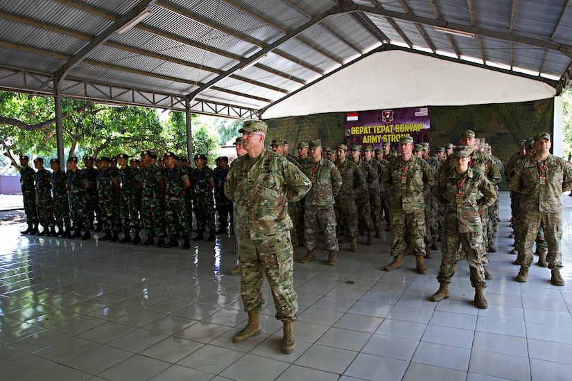 Indiana Army National Guardsmen from the 76th Infantry Brigade Combat Team stand in formation with their Indonesian army counterparts during the opening ceremony for Exercise Garuda Shield 18 in Puslatpur, Indonesia, July 29, 2018. Garuda Shield 18 is the third exercise in U.S. Army Pacific's second iteration of Pacific Pathways, a series of multinational engagements with ally and partner militaries in the Indo-Pacific region. Army photo by Spc. Joshua Syberg