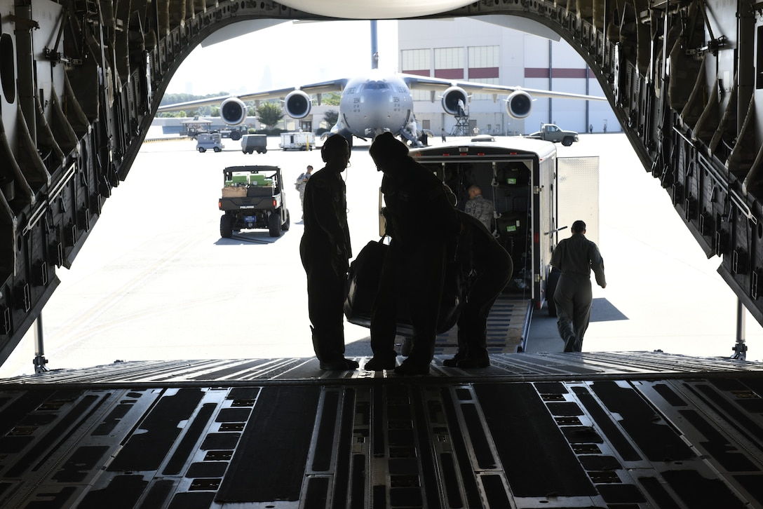 Airmen from the 156th Aeromedical Evacuation Squadron load medical equipment aboard a C-17 Globemaster III aircraft, for transport from North Carolina Air National Guard Base, Charlotte Douglas International Airport to Volk Field Air National Guard Base, Wisconsin, for a training exercise, July 9, 2018. (U.S. Air Force photo by Tech. Sgt. Nathan Clark)