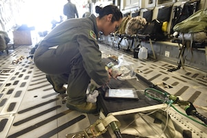 U.S. Air Force Airman 1st Class Kiara Rivera Cortes, 156th Aeromedical Evacuation Squadron, checks medical equipment aboard a C-17 Globemaster III aircraft prior to takeoff at the North Carolina Air National Guard Base, Charlotte Douglas International Airport, for transport to Volk Field Air National Guard Base, Wisconsin, for a training exercise, July 9, 2018. (U.S. Air Force photo by Tech. Sgt. Nathan Clark)