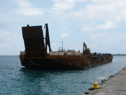 A second, larger barge arrives to collect the bulk of the 6 million pounds of scrap.