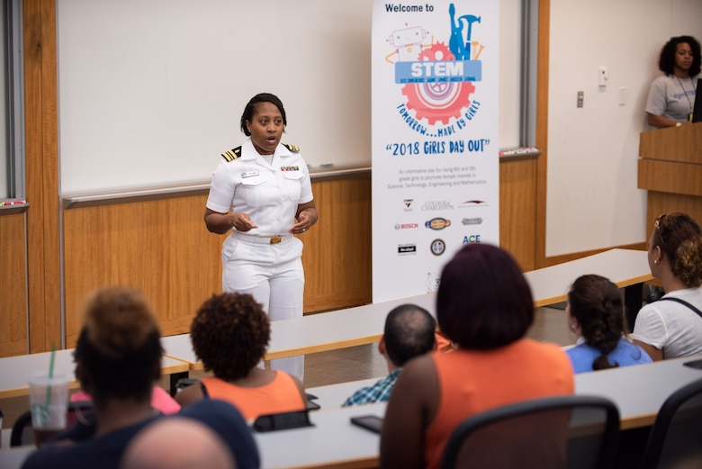 U.S. Navy Lt. Cdr. Crystal Bryant, Naval Health Clinic Charleston family nurse practitioner, gives closing remarks to more than 100 Girls Day Out attendees and their parents at College of Charleston as part of the seven annual Girls Day Out camp, hosted by SSC Atlantic in collaboration with Trident Technical College via Cyber Secure, College of Charleston, Bosch, Naval Health Clinic Charleston, Paul Mitchell the School Charleston, and NUCOR Steel Berkeley.