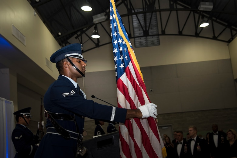 An Airman from Moody's Honor Guard presents the colors during a Senior NCO Induction ceremony, July 27, 2018, in Valdosta, Ga. The ceremony honored Moody's upcoming and newest Senior NCOs as they join the ranks of the highest enlisted tier. Senior NCOs lead and manage teams, provide guidance to leadership, translate leaders' decisions into specific tasks, and help Airmen internalize the Air Force core values. (U.S. Air Force photo by Airman 1st Class Eugene Oliver)